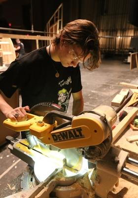 """Ron Harle does woodwork for a pices of the """"Urinetown"""" set Jan. 26. Photo by Bradley Wilson"""