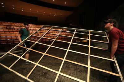 "Joey McGinn and Seth Angelino take down the set of ""Urinetown."" Photo by Bradley Wilson"