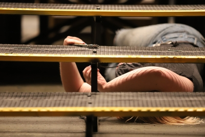 Emily Burns, theater junior, disassembles stairs on the platform on the Urinetown set on Monday, March 5, 2018. Photo by Jeromy Stacy