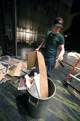 """Seth Angelino helps to down the set of """"Urinetown."""" Photo by Bradley Wilson"""