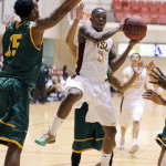 Men's basketball rally past second half surge