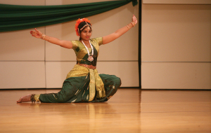 "Pragna Vemuri, a graduate student in computer science, dances ""Kuchipudi"" at the ""Journey of India"" — Diwali — festival in Akin Auditorium, Oct. 17, 2014. Photo by Sam Croft"