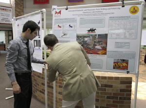 Alejandro Hernandez and Taylor Duval, mechanical engineering seniors, set up their poster April 24 at the EURECA Poster Presentations in the Clark Student Center Atrium. File Photo by Lauren Roberts.