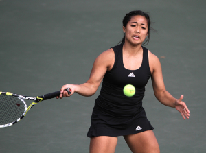 Lauren Pineda, sophomore in nursing, hits a forehand during the matches against Metro State University Friday afternoon. Pineda won her singles match 6-1, 6-0. 2014 File Photo by Lauren Roberts