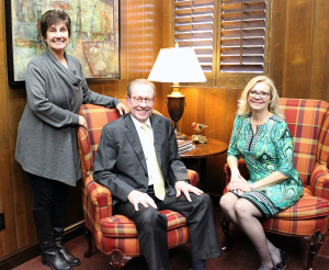 The Ladies' of the President's office: Ruth Ann Ray, assistant to the president, and Cindy Ashlock, executive assistant to the president, with Rogers. Debbie Barrow is not pictured. Photo by Rachel Johnson