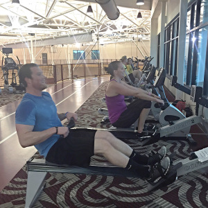 Associate Director of Housing, Angie Reay and Residence Hall Director, Clint Coulter compete against each other on the rowing machine in the Wellness Center for the indoor mini-triathalon, Tuesday April 28, 2015. Photo by Jessalyn Castro