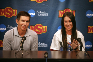 Brenna Moore, nursing senior, and Jeff Ray, golf coach, speak at a press conference with Moore discussing her national championship in golf, the first nationalship won by a Midwestern State University athlete. Photo by Bradley Wilson