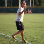 Soccer coach beats past record of 221 wins