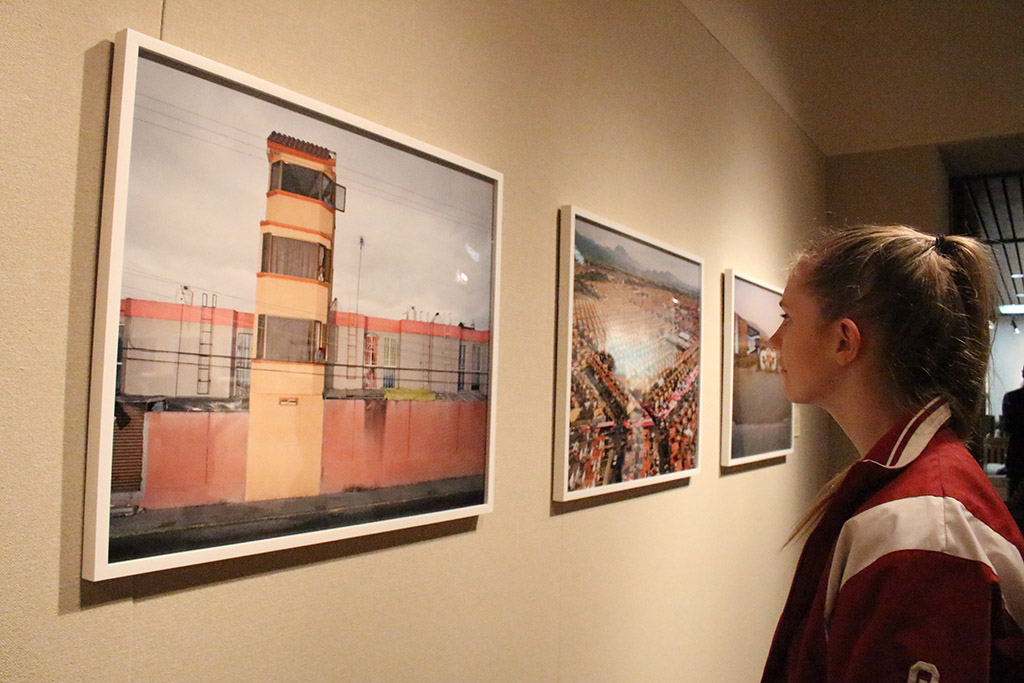 Makenzie Anderson, nursing, sophomore admiring a photo at the opening recepetion of Existe Lo Que Tiene Nombre: Contemporary Photography in Mexico displayed at Juanita Harvey Art Gallery on March 4th. Photos by Kayla White.