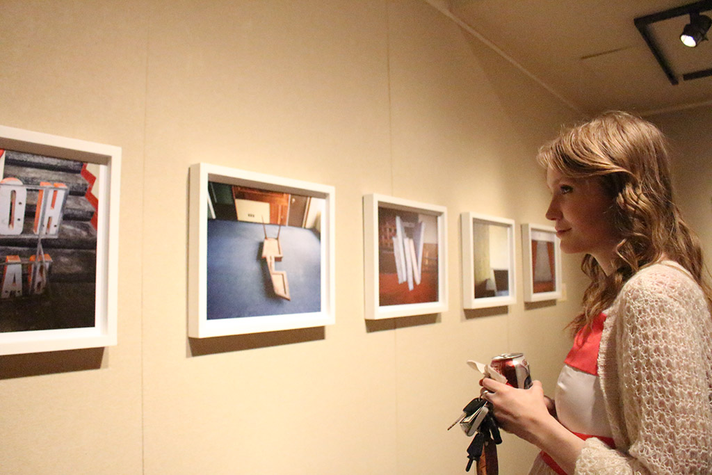Josie Wise, art freshman, review over the featured photos at the opening recepetion of Existe Lo Que Tiene Nombre: Contemporary Photography in Mexico displayed at Juanita Harvey Art Gallery on March 4th. Photos by Kayla White.