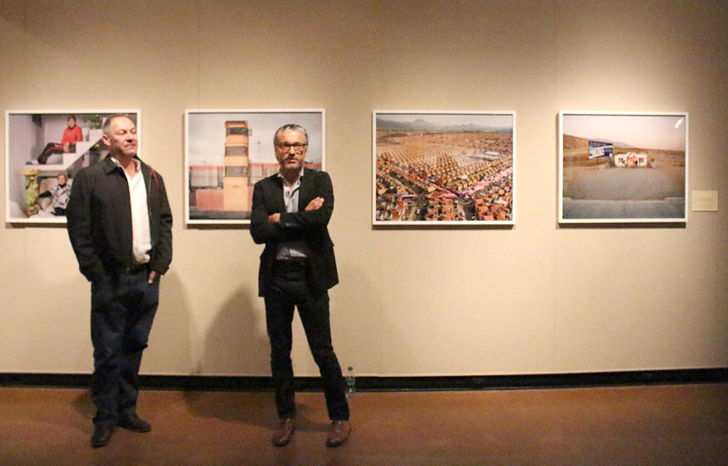 Photographers Sergio de la Torre and Javier Ramírez Limón giving an artist's statement at the opening recepetion of Existe Lo Que Tiene Nombre: Contemporary Photography in Mexico displayed at Juanita Harvey Art Gallery on March 4th. Photos by Kayla White.