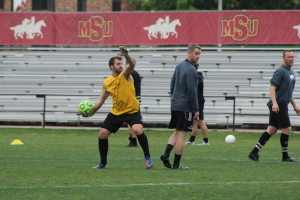 Noah Fazekas, mass communication junior, throws the ball back to some players during Alumni Week, in the Midwestern State Soccer Fields. Photo by Harley Warrick