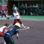 Softball team splits series with Commerce, enjoys turf