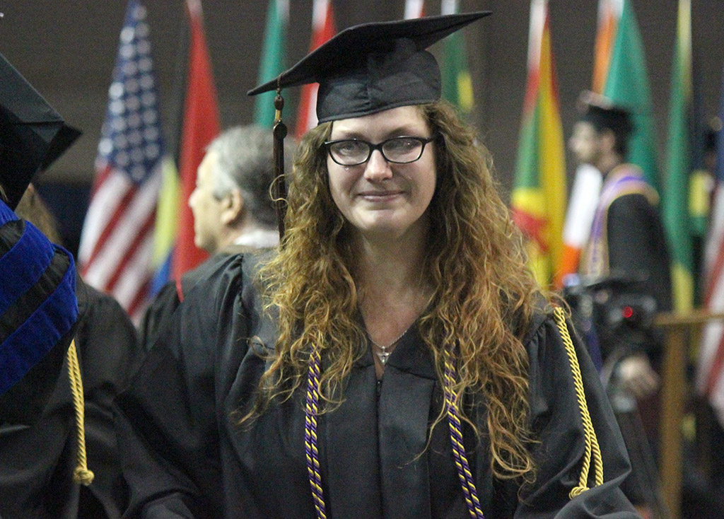 Glory Hartsfield, fine arts, is teary eyed after hugging her professors after walking the stage at Commencement in the Kay Yeager Coliseum, May 14. Photo by Rachel Johnson