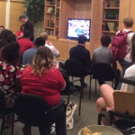 Students cram together for final debate