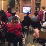 Students cram together for final debate