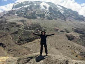Andrea Hoffman-Watson, alum, standing on Mt. Kilimanjaro. Photo contributed by Andrea Hoffman-Watson