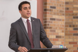 Manny Hoffman, Republican debater and political science senior speaks about immigration policy at the Midwestern State student debate in Dillard College of Business building. Nov 2nd. Photo by Izziel Latour