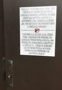 A sign warns concealled carry holders that their weapon is prohibited on the premises. Photo by Caleb Martin