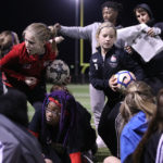 Soccer players further youth development through sports
