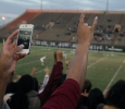 Students live streaming the highlights of the game while showing some school spirit at the game Saturday night. Midwestern defeated Missouri Science and Technology 40-23 at Memorial Stadium. Photo by Rachel Johnson