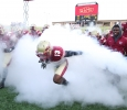 LaKeith Murray, business marketing senior, runs through smoke before the season opener against Missouri University of Science and Technology. Midwestern State University defeated Missouri S&T 40-23 Saturday night at Memorial Stadium. Photo by Lauren Roberts