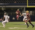 Jake Glober, quarterback, throws the ball at Midwestern State University v. Eastern New Mexico game at AT&T Cowboys Stadium in Arlington, Sept. 20, 2014. Photo by Rachel Johnson