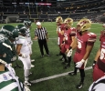 Jake Glover, accounting senior, Daniel Laudermilk, history junior, Ricardo Riascos, criminal justice senior, and Shadow Stokes, exercise physiology senior, join Eastern New Mexico captains for the coin toss at Midwestern State University v. Eastern New Mexico game at AT&T Cowboys Stadium in Arlington, Sept. 20, 2014. Photo by Lauren Roberts