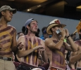 Kevin Nop, mechanical engineering freshman, Zach Davis, history and education freshman, Coleman Reidling, history sophomore, and Brandon Allen, mechanical engineering sophomore, cheers as members of the stang gang at Midwestern State University v. Eastern New Mexico game at AT&T Cowboys Stadium in Arlington, Sept. 20, 2014. Photo by Rachel Johnson
