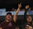 Crystal Afutit, wife of an MSU Mustang, and Lenora Alexander, MSU fan, cheers on Afutit's husband, defnesive line Bernard Afutiti, #30 at Midwestern State University v. Eastern New Mexico game at AT&T Cowboys Stadium in Arlington, Sept. 20, 2014. Photo by Rachel Johnson