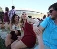 Samantha Ferguson, respiratory therapy junior, Meg Jones, nursing junior, and Nathan Craig, criminal justice junior, talk while tailgating at Midwestern State University v. Eastern New Mexico game at AT&T Cowboys Stadium in Arlington, Sept. 20, 2014. Photo by Lauren Roberts