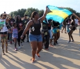 Students and participants in the CaribFest Parade 2015 start the parade in dance and song while waving the flags of different Caribbean islands, Sept. 25. Photo by Rachel Johnson