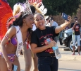 "Amy Hanley, management information system sophomore, takes a picture with Jorrey Martin, special education sophmore and MIss CaribFest 2015, at the beginning of the CaribFest Parade 2015, Sept. 25. ""I know the queen, we have been friends for a while,"" Hanley said. Photo by Rachel Johnson"