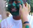 Francisco Ramos Armas, biology junior, gets his face and body painted in the Greenspace, that was provided by the University Programming Board, before the CaribFest Parade, that started between the parking lot behind Prothro-Yeager and the parking lot by the practice fields, it ended at the Quad, Sept. 25. Photo by Rachel Johnson
