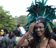 Rainah Winston, biology and chemistry senior, fixes her head piece while she dancees during the 2015 CaribFest Parade, Sept. 25. Photo by Kayla White