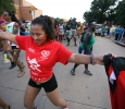 Iman Mendes, management information systems senior, dances along with other participants during the 2015 CaribFest Parade, Sept. 25. Photo by Bradley Wilson