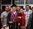 Timothy Muongchanh, nursing, poses with his family and friends after the Commencement Ceremony in Kay Yeager Coliseum Dec. 12, 2015. Photo by Francisco Martinez