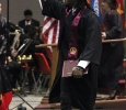 Bernard Griffin Jr., criminal justice, acknowledges members in the audience, then started to dance and shake hands with other graduates in attendance in the Kay Yeager Coliseum, Dec. 12. Photo by Rachel Johnson