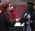 Suzanne Shipley, university president, congraduates Chimatara Nwabuko, nursing, as she walks across the stage at the Commencement Ceremony in Kay Yeager Coliseum Dec. 12, 2015. Photo by Francisco Martinez