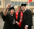 Cameron Hieb, athletic training, Robert Christian Magruder, athletic training, and Courtney Lyn Phillips, athletic training, take a group selfie at Midwestern State University graduation, May 16, 2015 at the Kay Yeager Coliseum. Photo by Rachel Johnson