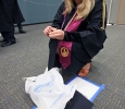 Kristan Aduddelll, math, gets a pin out of the box to put on her gown while waiting to be taken to the Kay Yeager Colisieum at Midwestern State University graduation, May 16, 2015 at the Kay Yeager Coliseum. Photo by Rachel Johnson