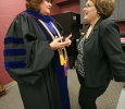 Deborah Garrison, vice president, talks with Debbie Barrow, director of board and government relations, in the green room before the ceremony at Midwestern State University graduation, May 16, 2015 at the Kay Yeager Coliseum. Photo by Rachel Johnson