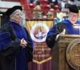 Retiring University President Jesse Rogers names Betty Bowles, associate nursing professor, the Hardin Professor at Midwestern State University graduation, May 16, 2015 at the Kay Yeager Coliseum. Photo by Rachel Johnson