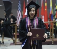 Sabina Marroquin, history, excitedly holds her diploma after walking the stage at Midwestern State University graduation, May 16, 2015 at the Kay Yeager Coliseum. Photo by Rachel Johnson