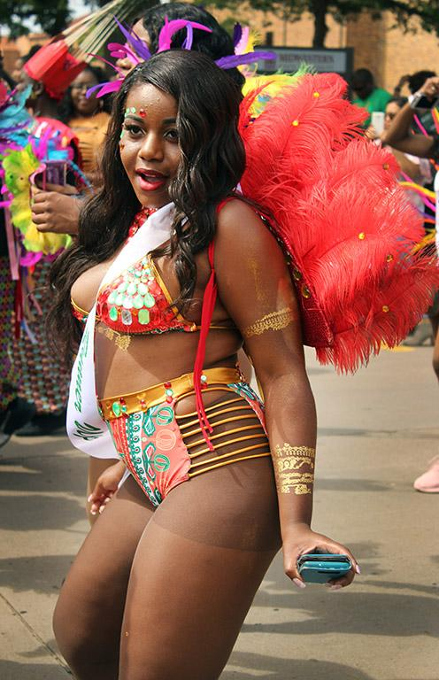 Valandra Jno Marie, management freshman, poses for the cameras during the Caribfest Parade that looped from Dillard to Jesse Rogers Promenade Sept. 30. Photo by Rachel Johnson