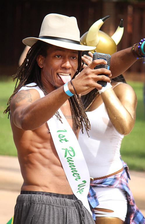 Edward Collins, psychology freshman, takes a selfie at the beginning of the Caribfest Parade that looped from Dillard to Jesse Rogers Promenade Sept. 30. Photo by Rachel Johnson