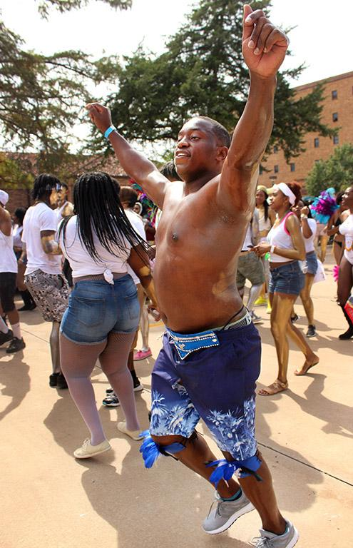 Akeem Shaw, accounting senior, runs through the Caribfest Parade hyping people up by dancing and singing the songs. Photo by Rachel Johnson