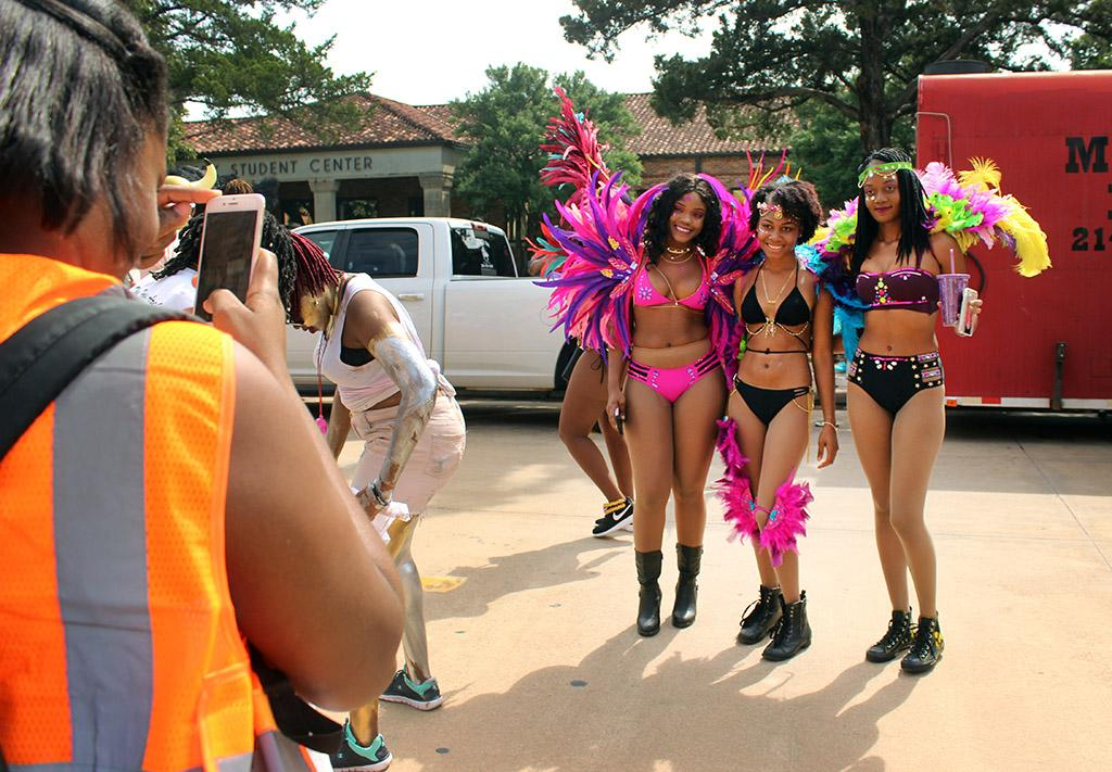 Danielle Dowe, chemistry and biology senior, J'anne Robinson, nursing junior, and Annise Aaron, English freshan, gets their photo taken during the Caribfest Parade that looped from Dillard to Jesse Rogers Promenade Sept. 30. Photo by Rachel Johnson