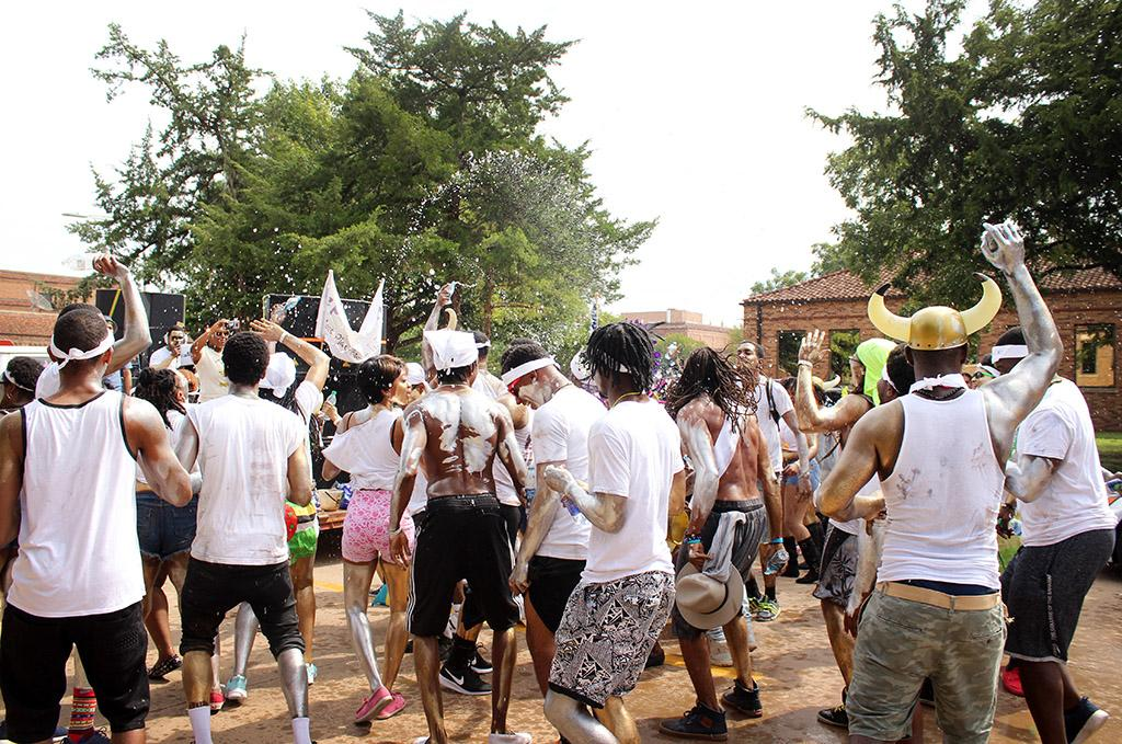 Participants in the Caribfest Parade throw water around on each other when the parade got in front of the Clark Student Center Sept. 30. Photo by Rachel Johnson