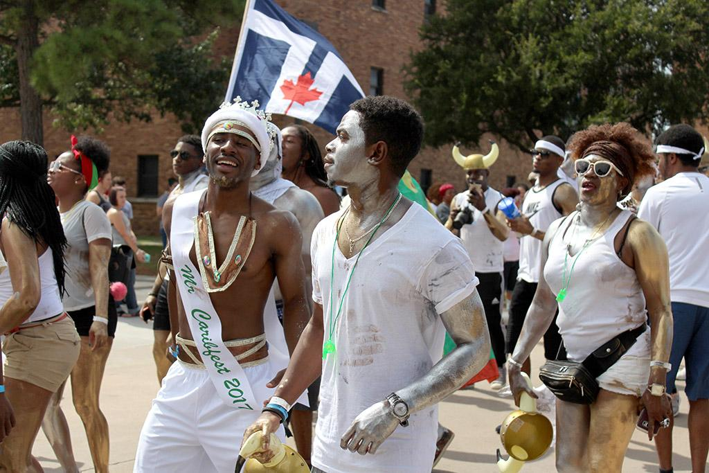 Ferdine Le Blanc, Art junior, and Rocksen Jean-Louis, winer of Mr. Caribfest 2017, show the Caribbean pride by being dressed in white and metalic paint for the 2017 Caribfest parade held in the Dillard parking lot Sept 30. Photo by Marissa Daley